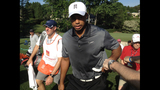 Tiger Woods draws massive crowd at pro-am - (8/25)