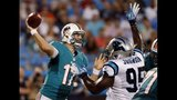 IMAGES: Cam leads Panthers to win over Dolphins - (7/25)