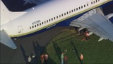 NASCAR plane stuck in grass_2731052