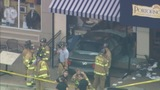 Woman drives her car through restaurant's… - (8/10)