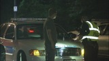 IMAGES: Police conduct DWI checkpoint - (4/9)