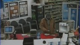 Surveillance photos of pharmacy robbery - (3/8)