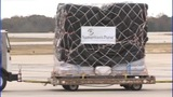 IMAGES: Samaritans' Purse works to load plane… - (1/9)