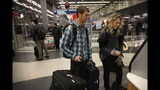 IMAGES: Travelers embark on holiday travel day before - (11/12)