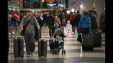 IMAGES: Travelers embark on holiday travel day before - (10/12)