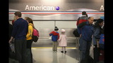 IMAGES: Travelers embark on holiday travel day before - (9/12)