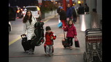 IMAGES: Travelers embark on holiday travel day before - (5/12)