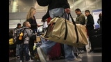 IMAGES: Travelers embark on holiday travel day before - (6/12)