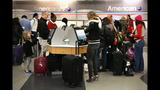 IMAGES: Travelers embark on holiday travel day before - (3/12)