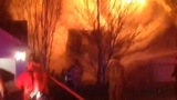 IMAGES: House fire erupts in east Charlotte - (6/6)