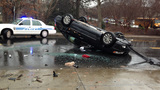 IMAGES: Car flips near uptown - (3/9)