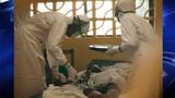 Dr. Kent Brantly, left, administering a drug. Photo courtesy of Samaritan's Purse._5783991