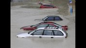 Flooded cars are parked at an apartment complex in Columbia, S.C., Sunday, Oct. 4, 2015. The rainstorm drenching the U.S. East Coast brought more misery Sunday to South Carolina, cutting power to thousands, forcing hundreds of water rescues and closing many roads because of floodwaters. (AP Photo/Chuck Burton)