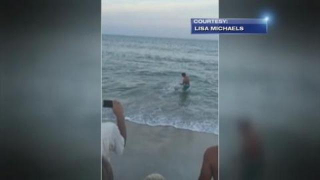 CRAZY VIDEO: Man drags shark back into ocean at Kure Beach