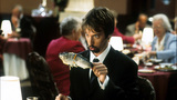 Tom Green holding up fish in restaurant in a scene from the film 'Freddy Got Fingered', 2001. (Photo by 20th Century-Fox/Getty Images)