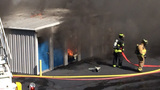 Firefighters struggle to contain flames at Burke Co. storage facility