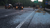 Interstate 77 covered with shards of glass after wreck