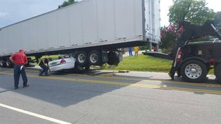PHOTOS: Man survives after tractor-trailer drags car