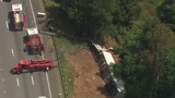 Tractor-trailer crashes down embankment on I-85 near Belmont