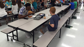 FSU player visits elementary school, has lunch with boy with autism