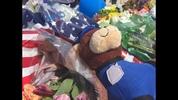 A memorial is growing on fallen Shelby officer Tim Brackeen's patrol car.