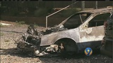 Remains of 2 bodies found inside burned car, authorities say