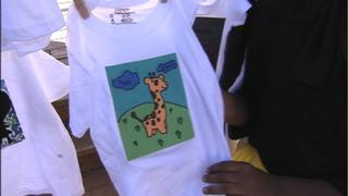 IMAGES: Local school honors 32 children who died from domestic violence
