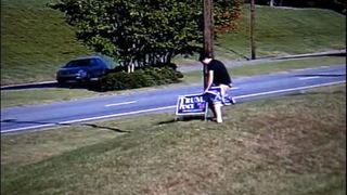 Man caught on camera stealing Trump signs from business