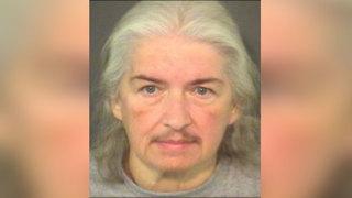 Boy found with dead chicken around his neck sues former foster mother