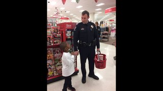 PHOTOS: CMPD officers, Target help children buy Christmas gifts for…