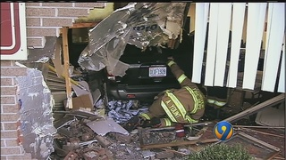 Fire chief rescues man, daughter after SUV slams through building