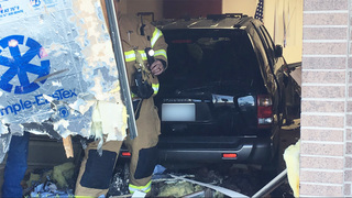 Man hospitalized, daughter unhurt after SUV slams into building