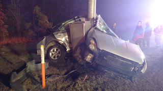 Car wraps around pole in Huntersville; driver escapes
