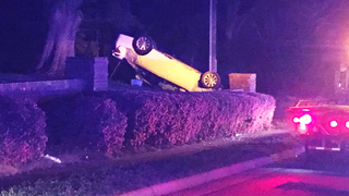 IMAGES: Stolen car overturns after chase through west Charlotte