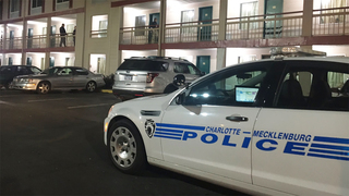 Police search for gunman after woman shot at north Charlotte motel