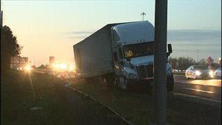 PHOTOS: Big rig scatters debris across I-77