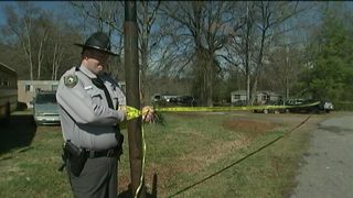 Investigators find body in makeshift grave in Statesville woods