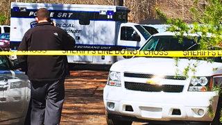 Investigators find body in makeshift grave in Statesville woods