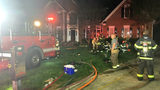 IMAGES: Fire destroys family home in Huntersville - (3/4)