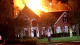 IMAGES: Fire destroys family home in Huntersville - (1/4)