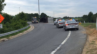 Tractor-trailer carrying watermelons overturns on I-85/I-77 ramp