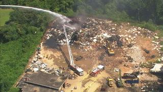 Firefighters battle scrap yard fire in north Charlotte