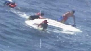 Coast Guard rescues 5 after boat capsizes 8 miles off NC coast