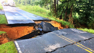 PHOTOS: Mallard Creed Road closed after flooding washes away roadway