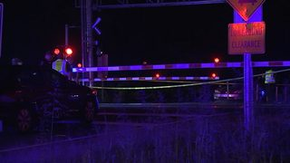 Police: Woman lifted gate, crossed tracks before struck, killed by Amtrak train