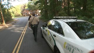 Channel 9 anchor rides with Meck Co. deputies serving domestic violence warrants