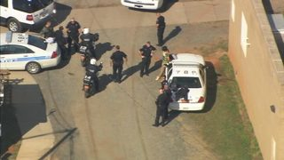 channel 9 is asking why the person is in custody and if police are searching for anyone else