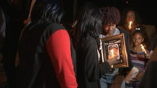 Family holds vigil for slain 2-year-old