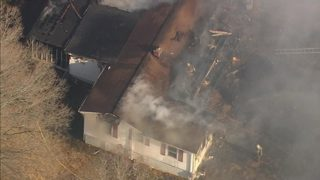 IMAGES: Firefighters battle heavy smoke, flames at Gastonia home