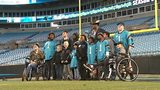 Cam Newton treats young patients to Panthers game, luxury suite